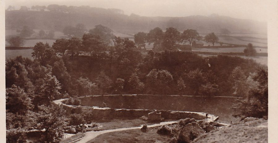 View of Hind Wheel mill dam ('The Round Pool') and derelict buildings in about 1950. From the KK collection.